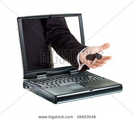 A hand sticking through a laptop giving a key. Isolated on white.