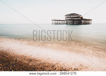 The Old Remains Of Brighton Pier Left Standing In Sea With Beautiful Waves In Brighton And Hove's We
