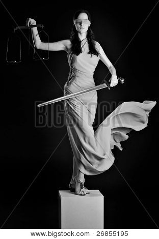 Statue of justice. Blind Woman with scale and sword.