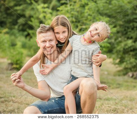 Happy family hugging and smiling together
