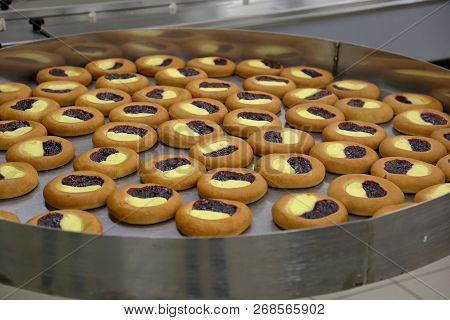Freshly baked confection in bread and sweets factory poster
