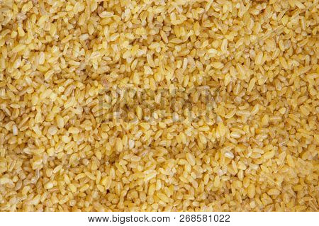 Bulgur Wheat Yellow Background And Texture Pattern