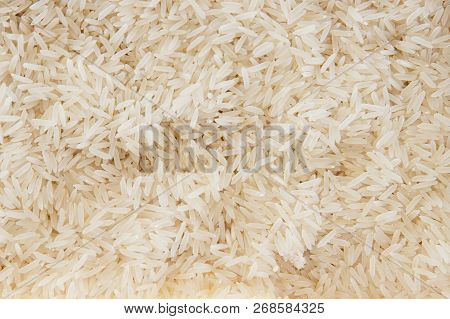 Rice, White Grains. Basmati. Unpolished, Uncooked, Natural, Diet, Raw Asian Cuisine, Dish. Texture P