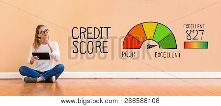 Excellent Credit Score With Young Woman Holding A Tablet Computer