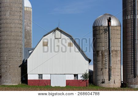 Grouping Of Silos And A Barn In Rural United States
