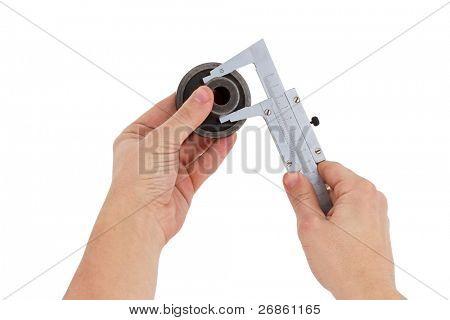 hand holding trammel tool on white