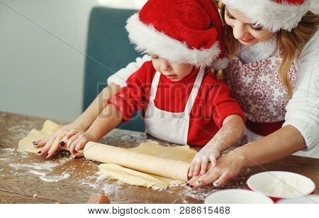 Happy Funny Mother And Child  Bake Christmas Cookies
