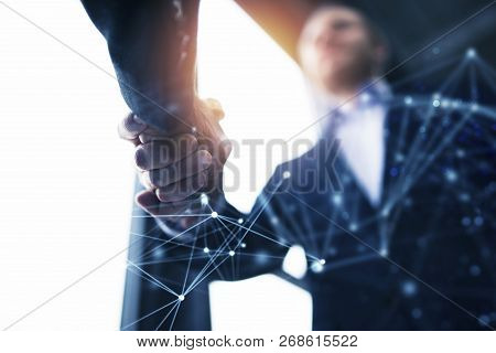 Handshaking Business Person In The Office With Network Effect. Concept Of Teamwork And Partnership.