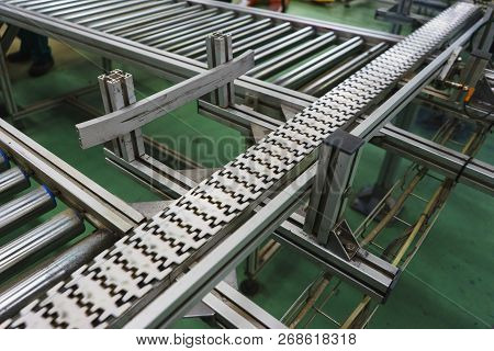 Production Equipment Conveyor Belt At Factory. Devices And Automatic Equipment For Packaging And Pac