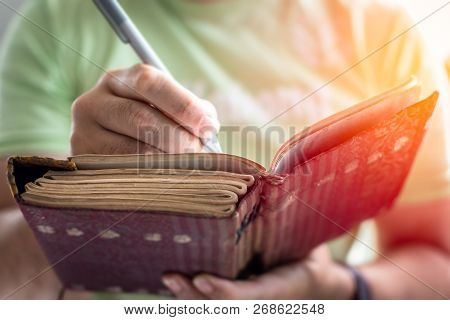 A Young Successful Person Taking Notes In A Personal Journal