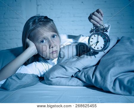 Cute Girl Feeling Exhausted Early In The Morning Having Trouble Getting Up In Child Insomnia Concept