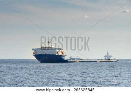 Blue And White Colour Project Cargo Ship Anchors In The Open Sea. Project Cargo Ship Is One Of The T