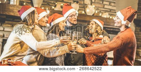 Friends Group With Santa Hats Celebrating Christmas With Champagne Wine Toast At Home Dinner - Winte