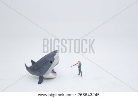 A Toy Wild Animals With The Hunter