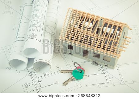 Small House Under Construction, Home Keys And Electrical Rolls Of Diagrams And Drawings For Project