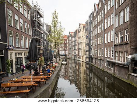 Amsterdam, Netherlands - April 20, 2017: Traditional Historic Dutch Gable Houses Beside Canal In Ams
