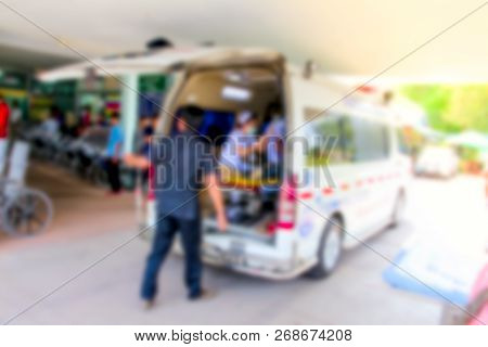 Blurred Of Emergency Medical Staff Team Transporting Patient To Hospital With Ambulance Into An Acci