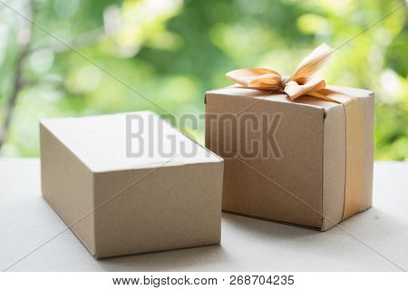 Craft Paper Gift Box Tied With Gold Bow. Gift Box Decoration Ideas.