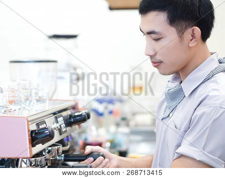 Closeup Asian Man Barista Preparing For Making Coffee At Cafe With Happy Feeling