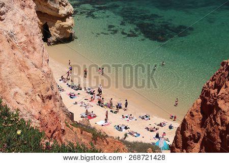 Algarve, Portugal - May 29, 2018: Tourists Visit Camilo Beach In Algarve Region, Portugal. Coastal R