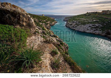 Beautiful Landscape Of Gozo, In Background Mgarr Ix-xini Tower And Malta. Mediterranean Sea.