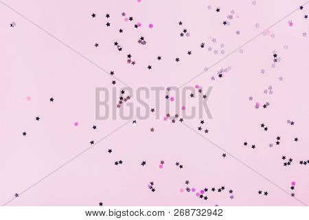 Pink Background With Multicolored Sparkles On It. Festive Concept.