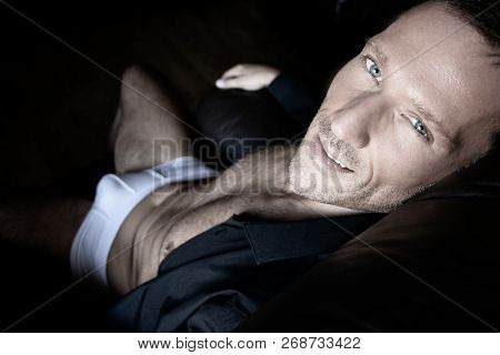 Good Looking Middle Aged Man Wearing Underwear And An Open Shirt Looking At Camera