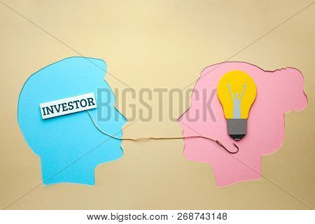 The Investor Is Looking For New Ideas For The Business Of Making Money. Two Human Head Silhouettes,