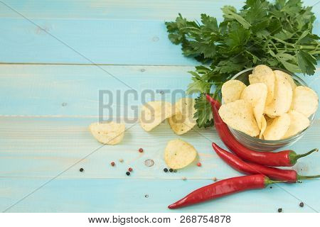 Potato Chips With Spicy In A Glass Bowl