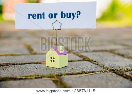 Buy Or Rent Property Concept. New House As Wish .text Message Buy Or Rent With Wooden Small House. B