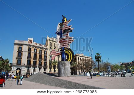 BARCELONA, SPAIN - APRIL 17, 2018: The Head of Barcelona (Cap de Barcelona) on the harbour front at Port Vell. The surrealist sculpture was created in 1992 by artist Roy Lichtenstein.