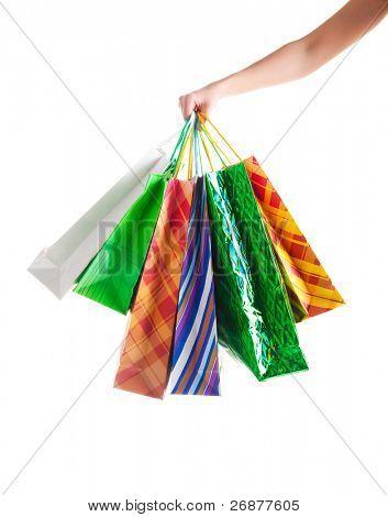 Shopper holding shopping bags. Shot on white background