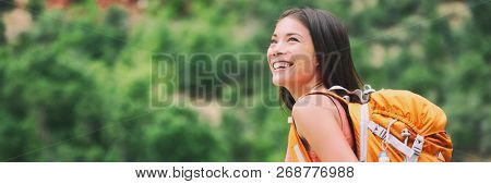 Hike outdoor active asian girl hiker enjoying camping trip in mountain forest walking on trek trail with backpack for backpacking summer vacation.