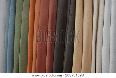 Many textile materials variety shades of colors horizontal