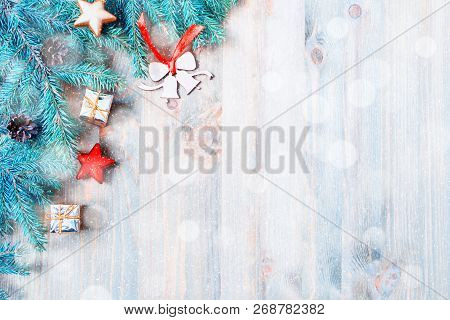 New Year and Christmas background. Christmas toys, blue fir tree branches on the wooden background. New Year and Christmas composition, free space for text, New year and Christmas still life