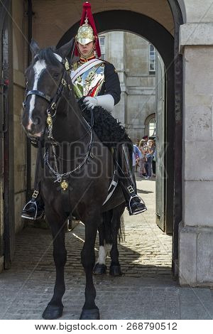 London, England, Uk - May 19,2014: Royal Guard Sitting In A Horse Guarding A Door