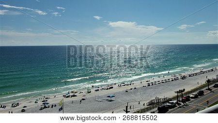 Wide Angle View Of The Blue Waters Of The Gulf Of Mexico Against The Blue Skies On The Beaches Of De