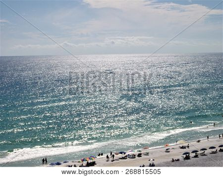 Molten Silver Ripples Reflecting On The Waters Of The Gulf Of Mexico In Destin, Florida.