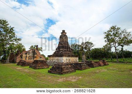 UNESCO World Heritage site Wat Chedi Si Hong in Sukhothai Historical Park, Sukhothai province, Thailand. poster