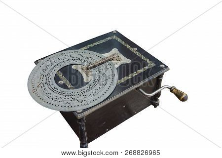 Old-time Music Box In A Black Wooden Box With A Punching Disk.