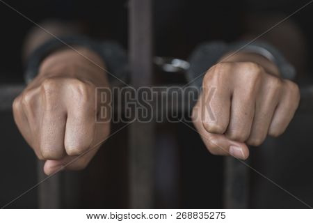 Man In Prison Hands Of Behind Hold Steel Cage Jail Bars,  Male Prisoners Were Severely Strained In T