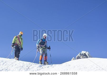 Mont Blanc, France - August 11, 2018: Mountaineers Climbing In Chamonix, France. Mont Blanc Is The H
