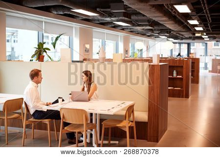Young Businessman Having Informal Interview In Cafeteria Area At Graduate Recruitment Assessment Day
