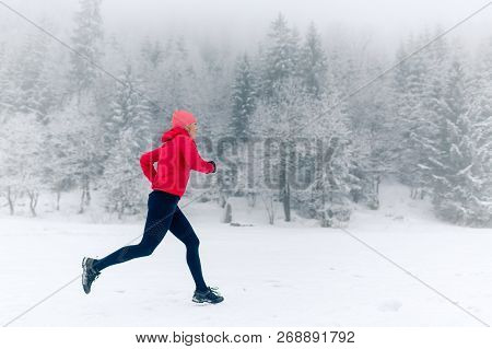 Happy Girl Running On Snow In Winter Mountains. Sport, Fitness Inspiration And Motivation. Young Hap