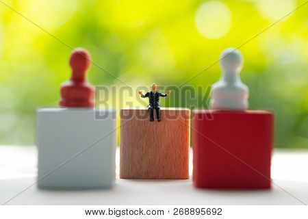 Miniature Businessmen Control Pawn Red And White For Business Strategy Or Business Planning. Strateg
