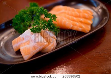 Raw Salmons Fillet On Dish In Restaurant. Selective Focus