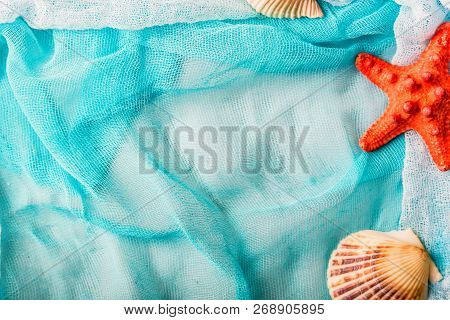 Seashells And Starfish On Cian Cloth Background
