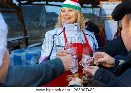 Hecha, Ukraine - Jan 27, 2018: Pork Butchers Competition. Degustation Of Traditional Hungarian Hard