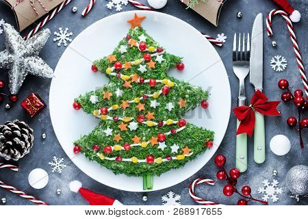 Christmas New Year Meal Idea - Creative Appetizer Salad Like A Christmas Tree With Festive Decoratio