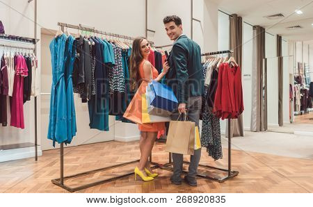 Couple shopping together in spacious fashion boutique